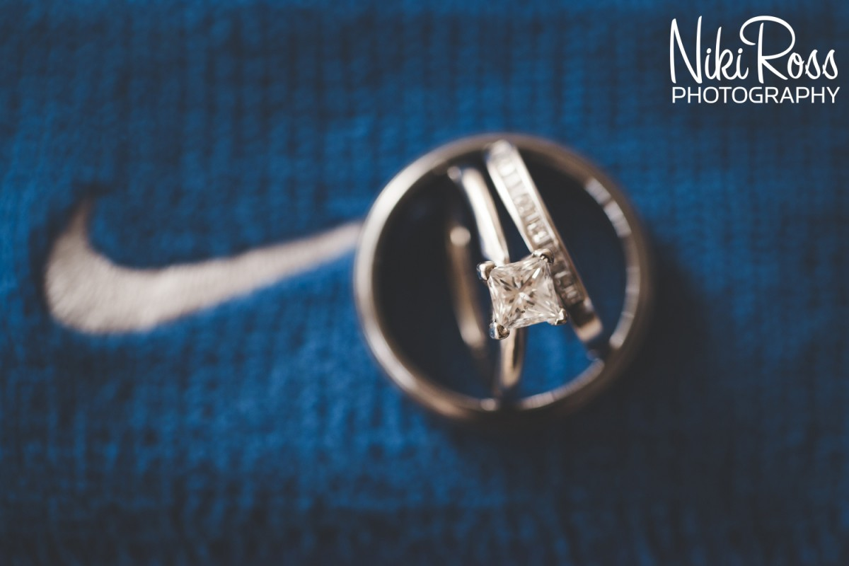 Wedding rings with the brides Nike Garter Belt. http://nikirossphotography.com