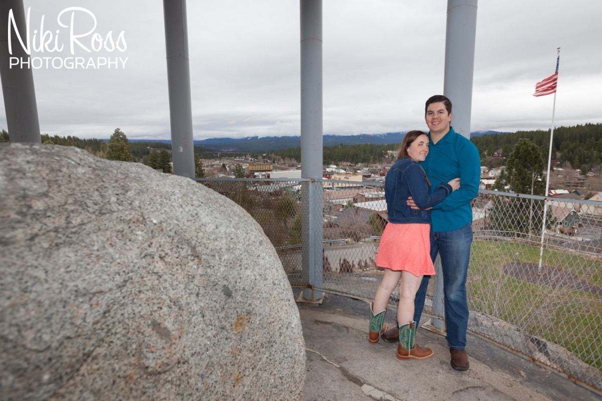 Truckee Engagement Session. Couple at rolling rock which views over downtown Truckee.