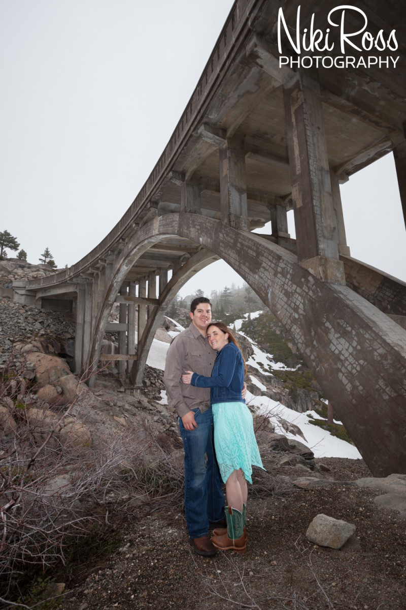 Truckee Engagement Session. Couple under Rainbow Bridge.